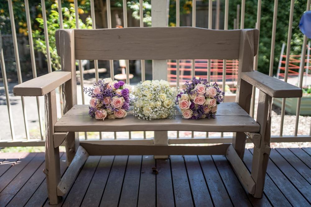 Pretty pink, purple & cream rose wedding boquet